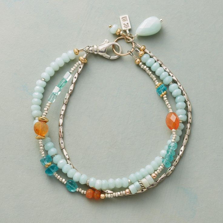 """FIRE AND WATER BRACELET -- Varied shapes of blue amazonite and apatite mix and mingle with fiery carnelian in our three strand bracelet. Sterling silver beads and lobster clasp, 14kt gold filled ring. Handmade in USA exclusively for Sundance. 7-1/2""""L."""