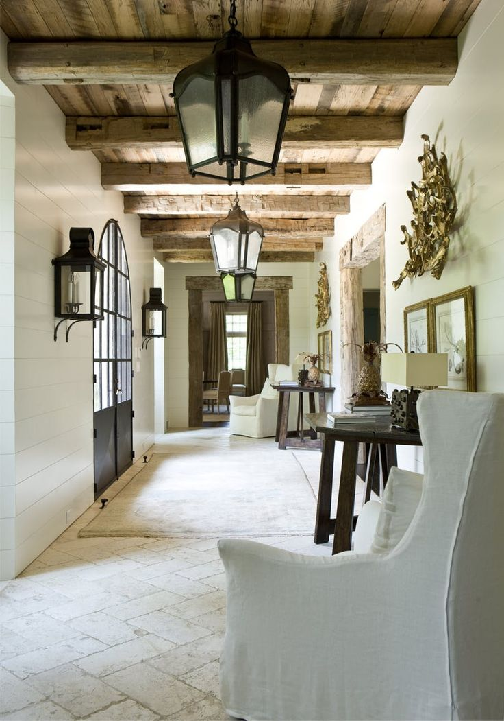 Those beams in contrast to the crisp white walls are beautiful!