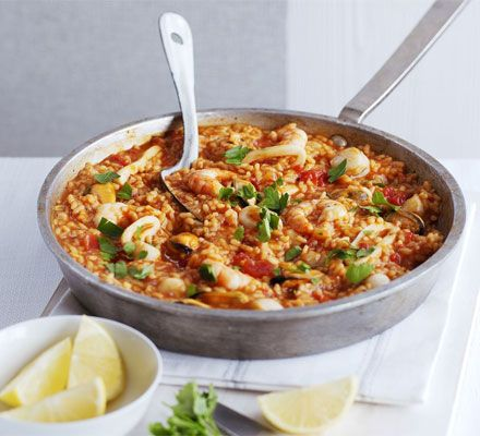 Easy Paella With Olive Oil, Onions, Hot Smoked Paprika, Risotto Rice, Dry Sherry, Chopped Tomatoes, Chicken Stock, Frozen Seafood, Lemon, Flat Leaf Parsley