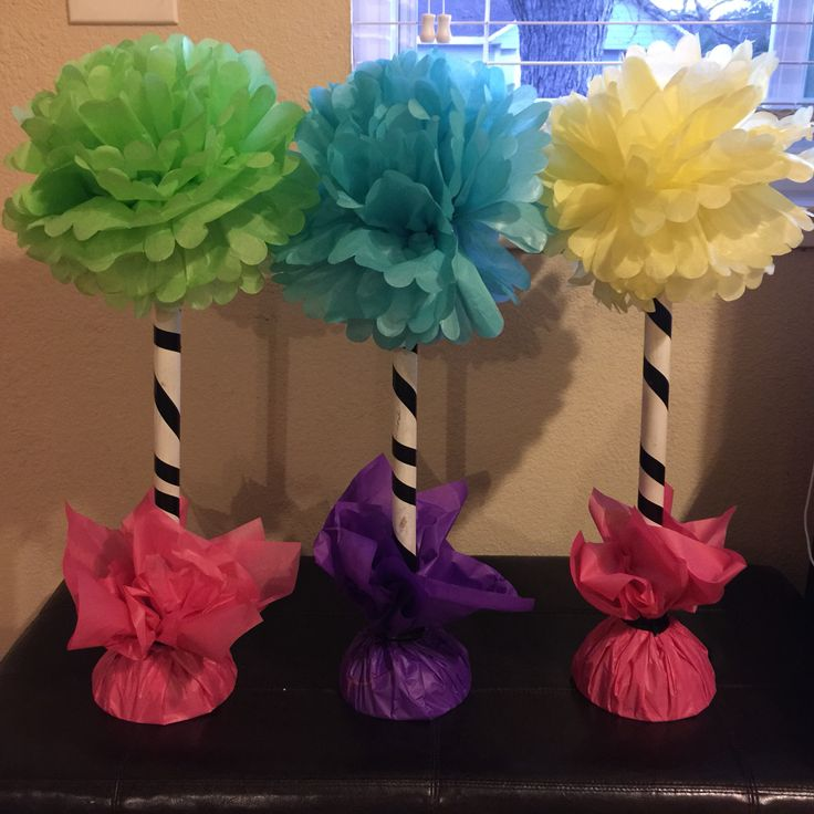Truffula Trees! Dollar Store: plunger, Pom Pom, electrical tape and tissue paper. Grab a cheap can of spray paint and you've got a tree! Happy Birthday Dr. Seuss!