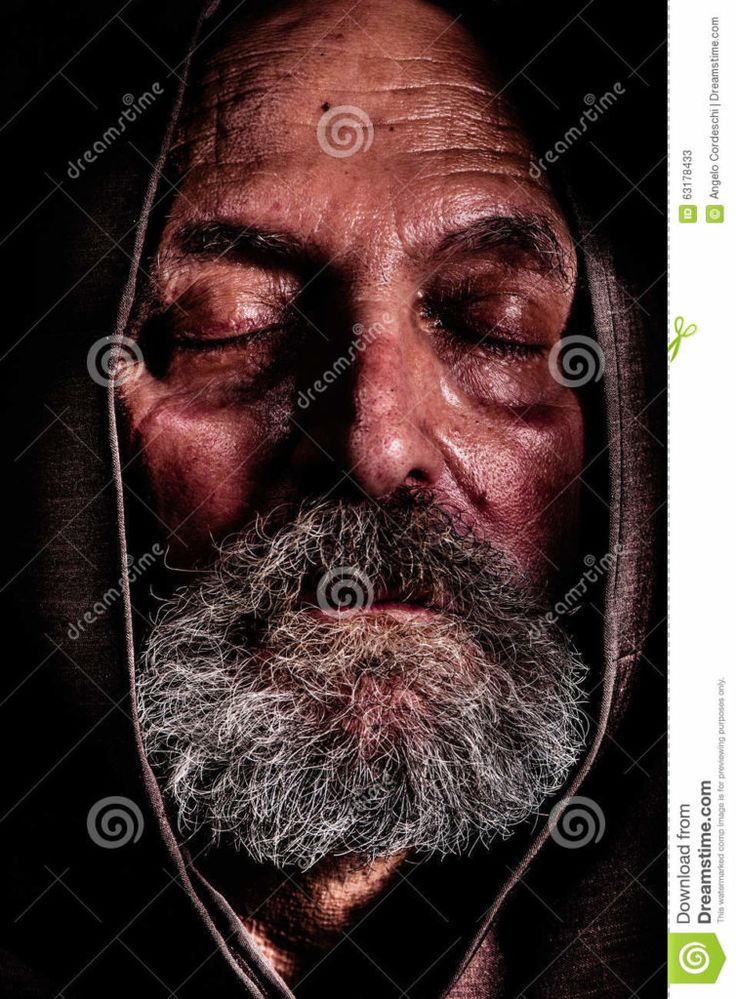 Homeless Capuchin friar Bum poverty suffering. Homeless, a Capuchin friar. Bum poverty and suffering Homeless, a Capuchin friar. Bum poverty and suffering. Close portrait of an elderly man with eyes closed and with a hood over his head. Concept of abandonment, suffering, and aging. Effect high definition range, dragan.