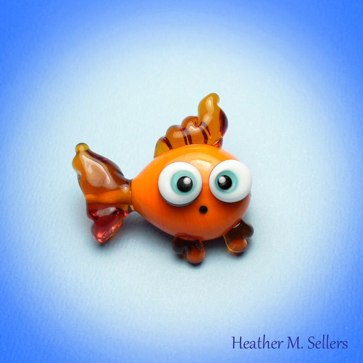 Goldie:  Bad fin day or rocking the Elvis hair-do?  You decide.  A lampwork glass bead designed by Heather Sellers.  #heathersellers #glass #fish #goldfish