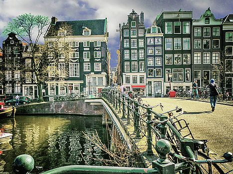 A typical area of Amsterdam, canal, bikes, and beautiful houses by George Westermak#GeorgeWestermakFineArtPhotography#landscape#travel#ArtForHome