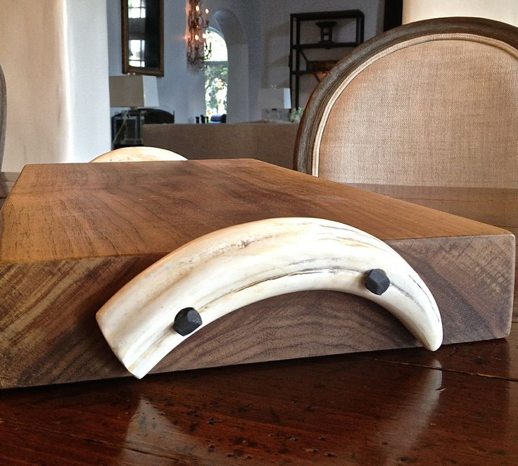 DIRA Walnut & Warthog Tusk Cheese Board  A handcrafted item, our warthog tusk cheese board is made of walnut and no two are exactly alike. Shop them here http://www.diralife.com/walnut-warthog-tusk-cheese-board/