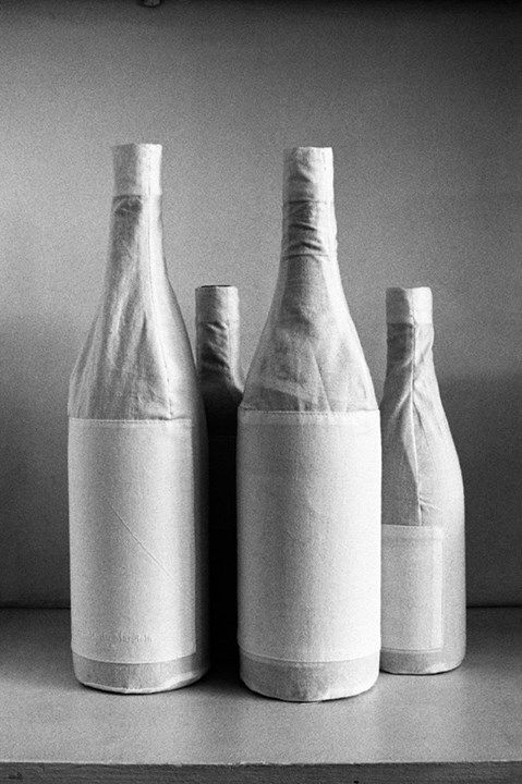 COTTON BOTTLE COVERS This white cotton cover renders bottles incognito, covering various bottle sizes from wine to Sake.   Limited edition item for Japan. Available from July 31, 2013 at L'Espace Maison Martin Margiela at Isetan Shinjuku, Tokyo.