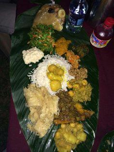 Trinidadian Food Platter  Curry Buss-Up-Shot etc on a banana leaf