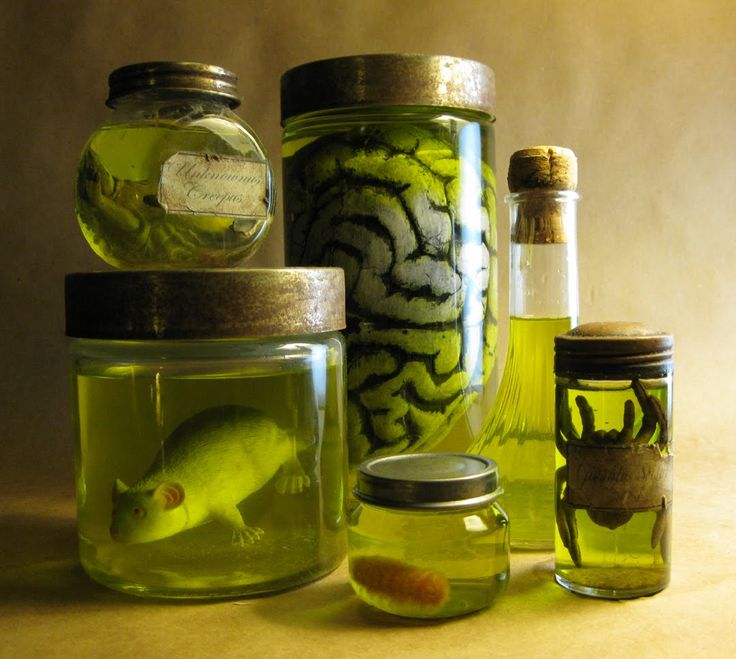 DIY: Creepy Specimen Jars for Halloween decoration. 7 drops yellow and 1 drop green food coloring.  More great tips too.