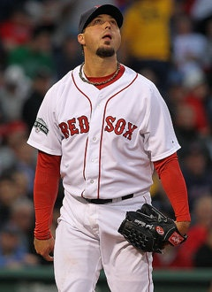 Josh Beckett Red Sox pitcher loves chicken and beer in club house and playing golf when he has a sore back but can't pitch the day before