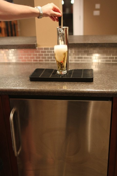 Jesus woman pour the beer right if you paid to have a kegerator installed in your kitchen -.-  Cool idea though