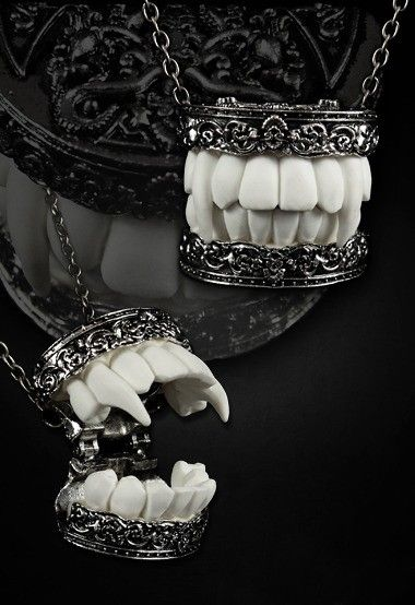 Aristocrat Vampire Fangs - Restyle ...Shit like Twilight has ruined vampires for good but these are simply awesome