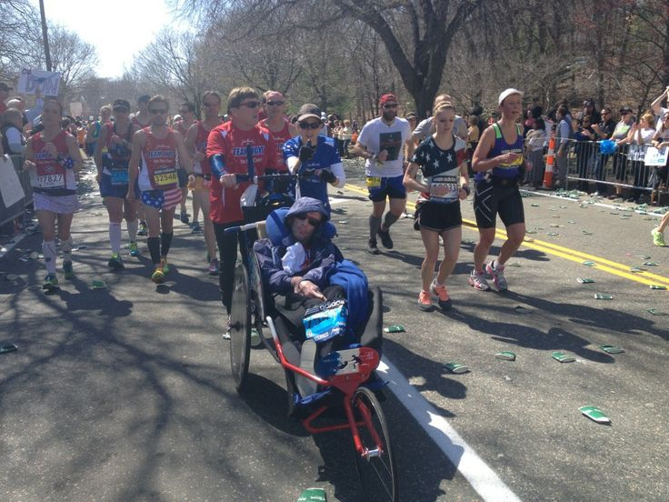 Many ran with loved ones, like Team Hoyt, who drew huge cheers: