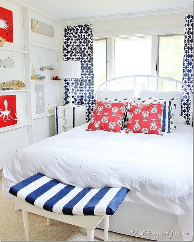 A cute nautical bedroom in bright white, red and blue with all kinds of coastal motifs built in. For more awesome coastal bedrooms, browse Completely Coastal here: http://www.completely-coastal.com/search/label/Bedrooms