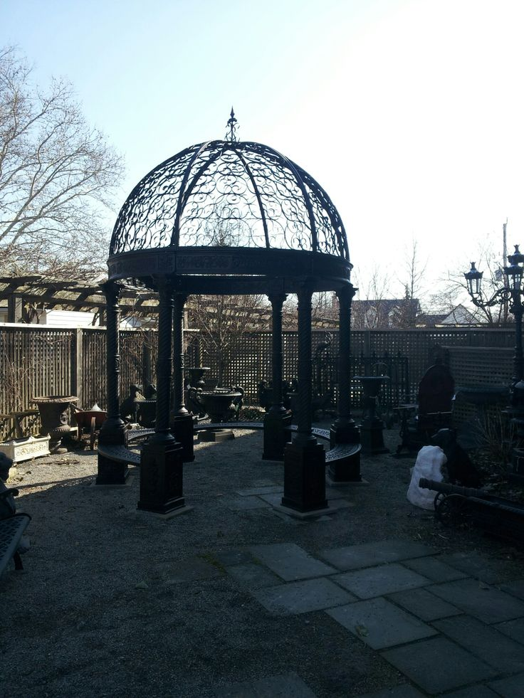 Courtyard renovation. Cast iron gazebo with built in benches and dome top.