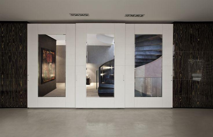 Sliding doors wardrobe, BORDO 32 door from cm. 151 made in white matt cocco leather and bronze mirror. Handle in white crocodile.