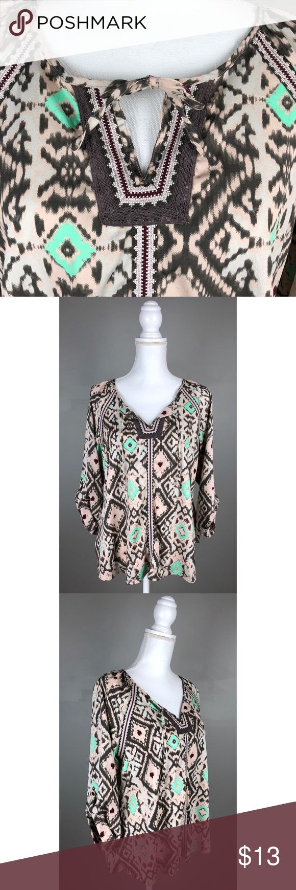 """BKE Boutique Peasant Southwestern 3/4 Sleeve Top IN EXCELLENT- like NEW condition!!  BKE Boutique (Buckle brand). Gray/ taupe, silver, light pink, mint green and burgundy. 3/4 roll-tab sleeves, embroiderydetailing on the front, v-neck with 2 strings that can be tied in a bow or left un-tied. """"Silk"""" like material! Flowy!Picturesare a part of the description.  100% Polyester, Machine wash  {Measurements taken flat without stretching} Armpit to armpit approx. 19-19.5"""" Length approx. 25""""…"""