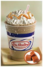 COPYCAT TIM HORTONS' ICED CAPPUCCINO RECIPE 4 c milk  1 c nondairy coffee creamer 2 tsp vanilla  2 Tbsp instant coffee 3 Tbsp hot chocolate mix 1/4 cup cold milk    Heat milk to boil, remove. Add creamer, vanilla, instant coffee and hot chocolate mix; stir well. Pour mixture into a container with a lid; put into freezer and freeze until very firm, but slightly slushy.