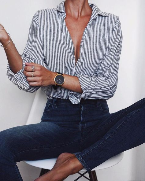 skinny jeans + button-up = uniform; minus the low cut, this could even work for the office; love the messy rolled sleeves, front tie of the shirt (mixing up the tuck-in), & the high waist. not to mention the monochromatic blues