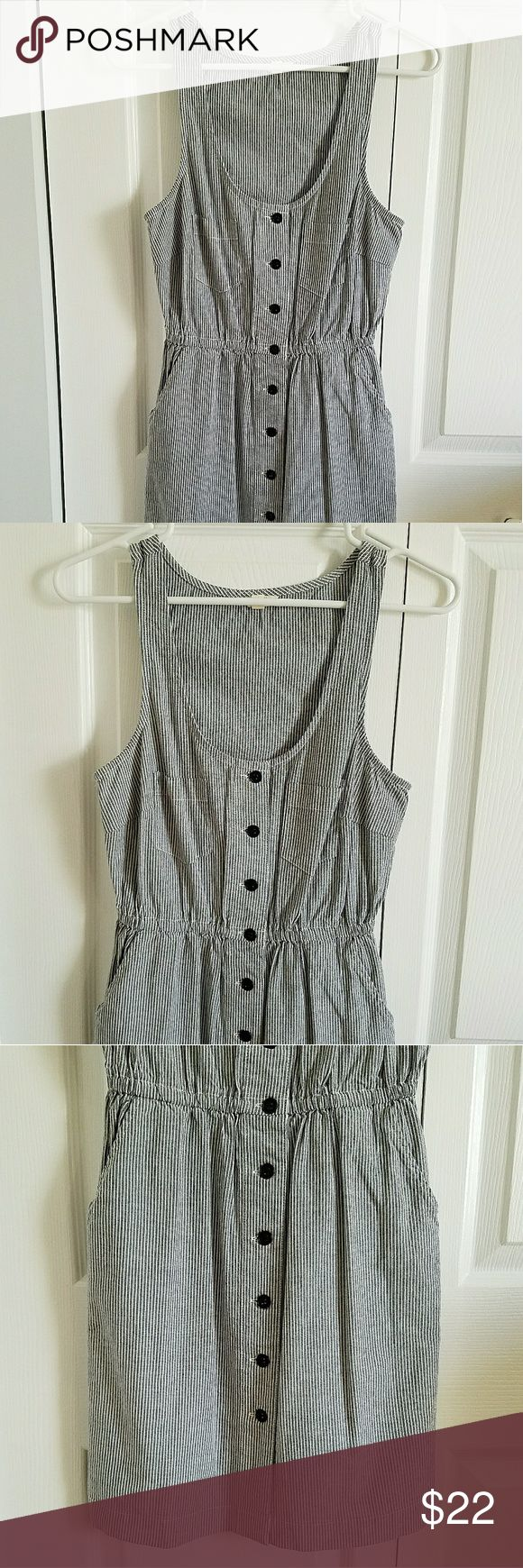 FOREVER 21 Sleeveless Button Down Dress Striped Women's FOREVER 21 sleeveless button down dress. Size Small. Short length. Gray blue & white vertical stripes. Scoop neck. Empire waist, with an elastic band. Two breast pockets, as well as two side pockets. 97% cotton, 3% spandex.  Measurements (while lying flat): Shoulder to shoulder- 11 inches Armpit to armpit- 16 1/2 inches Sleeve length- n/a Top to bottom hem- 33 inches  PREOWNED. Never worn. No rips, stains or odor. Forever…