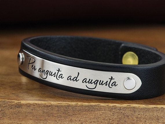 This personalized 1/2 leather bracelet, carefully hand crafted from top grade leather and durable stainless steel, features one line of personalized text of your choosing ( 17 characters max ). Hand made in Coeur DAlene Idaho, USA!  MADE TO ORDER Item takes up to ( 3-5 ) Business Days to make ENGRAVING 17 Characters ( letters, numbers, symbols, etc) Per Line / One Line Only  BRACELET SIZE - See last photo above - Use our sizing chart to find correct bracelet size for your wrist. - M...