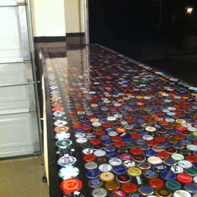 Bottle cap bar top in our garage.   Garage Bar for the ...