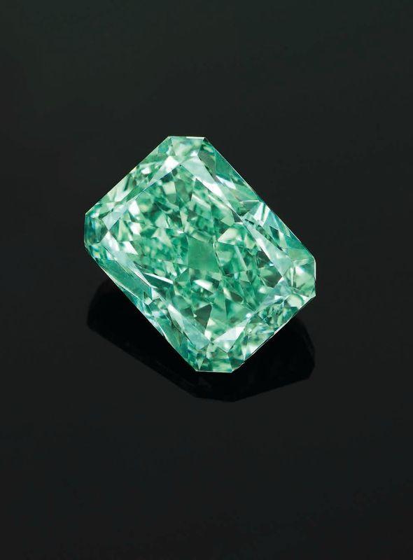 The Aurora Green. A superb 5.03 carats rectangular-cut fancy vivid green diamond ring