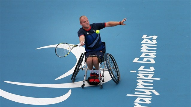 Marc McCarroll of Great Britain plays a shot during the men's Singles round 64 match against Tom Egberink of the Netherlands on Day 3 of the London 2012 Paralympic Games at Eton Manor.