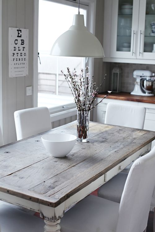 Rather too much white going on but the table and pendant light work well together.