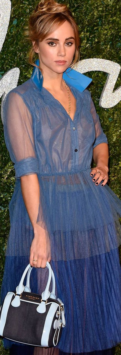 Campaign star Suki Waterhouse wearing a pleated tulle shirt dress in vivid blue