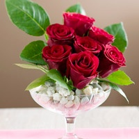 Spread romantic flowers around your home for Valentine's Day or another special occasion with these three creative arrangements made from a single bouquet of red roses.