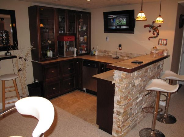 Love this corner kitchen.  I also want the popcorn popper and small fridge. The bar and stools also but not in that design.