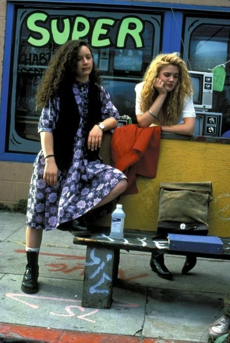 "48 Pictures That Perfectly Capture The '90s  #20. Drew Barrymore and Sara Gilbert with the word ""Super"" behind them"