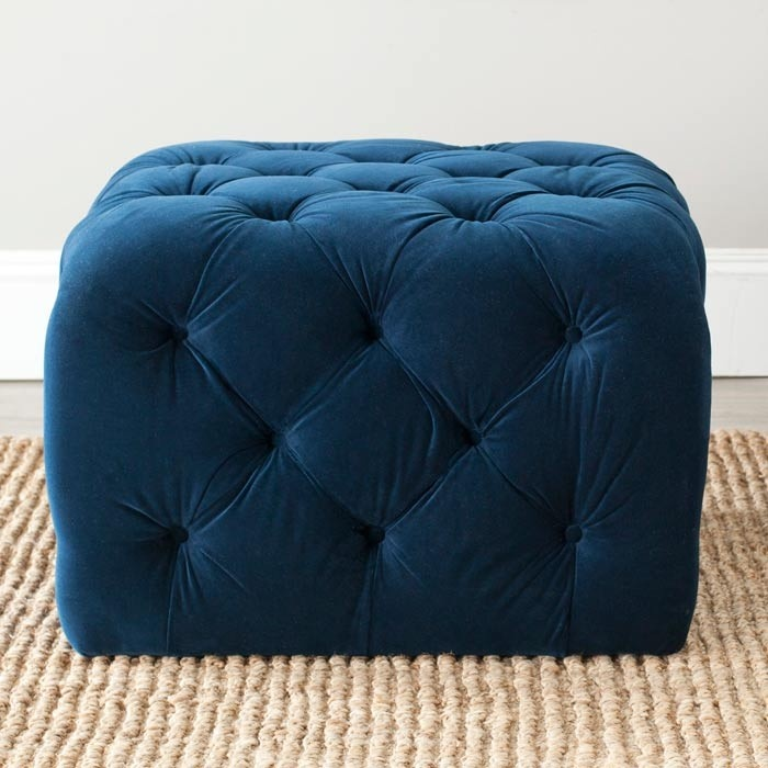 Button tufted navy ottoman