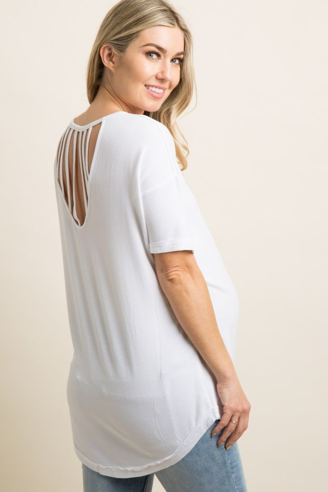A solid hued, semi-sheer maternity top featuring a trendy cutout back with a strappy accent, and a rounded neckline. Additional details include a raw cut cuff on short dolman sleeves and rounded hemline. This style was created to be worn before, during, and after pregnancy.
