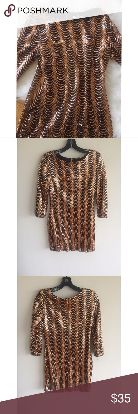 "Charlotte Russe Rose Gold Sequence Dress This dress is very pretty. There maybe some pieces of sequence missing. Overall really great condition. This dress measures approximately 30"" Long. The sleeves measure approximately 20"" Long. 100% Polyester Charlotte Russe Dresses Midi"