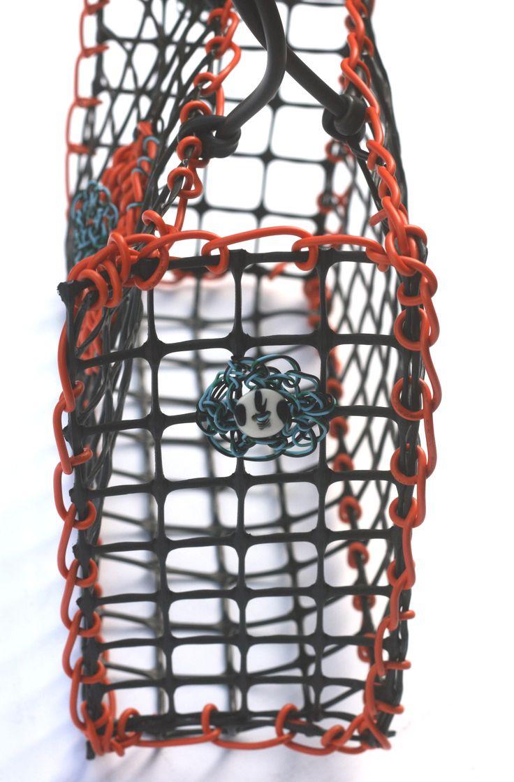 © Maritza Noa-Cabrera. Detail on the side for Vintage inspired orange handbag. Sold.