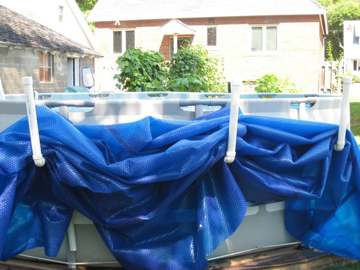 PVC saddles DH made for our Intex pool. Holds the solar cover while pool is in use. Can glue them together w/ PVC glue, but they come apart easily for winter storage. Use zip ties to anchor to uprights.