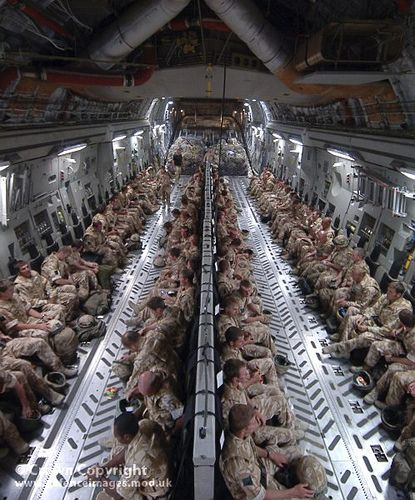 Troops from 16 Air Assault Brigade sit in the rear of a C17 Globemaster…