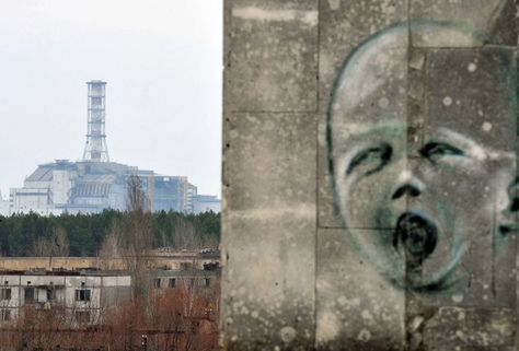 26 years later: Remembering the Chernobyl nuclear disaster - April 4, 2011: Graffiti is pictured on a wall in the ghost city of Pripyat near the fourth nuclear reactor (background) at the former Chernobyl Nuclear power plant. ...The concrete sarcophagus capping the reactor has developed cracks and is not considered failsafe.(Sergei Supinsky/AFP/Getty Images)