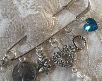 Silver plated kilt pin with charms to represent the wedding tradition, Something Old, Something New, Something Borrowed, Something Blue, which comes from an Old English rhyme about the four objects needed to secure wedded happiness - £7.50 + p&[