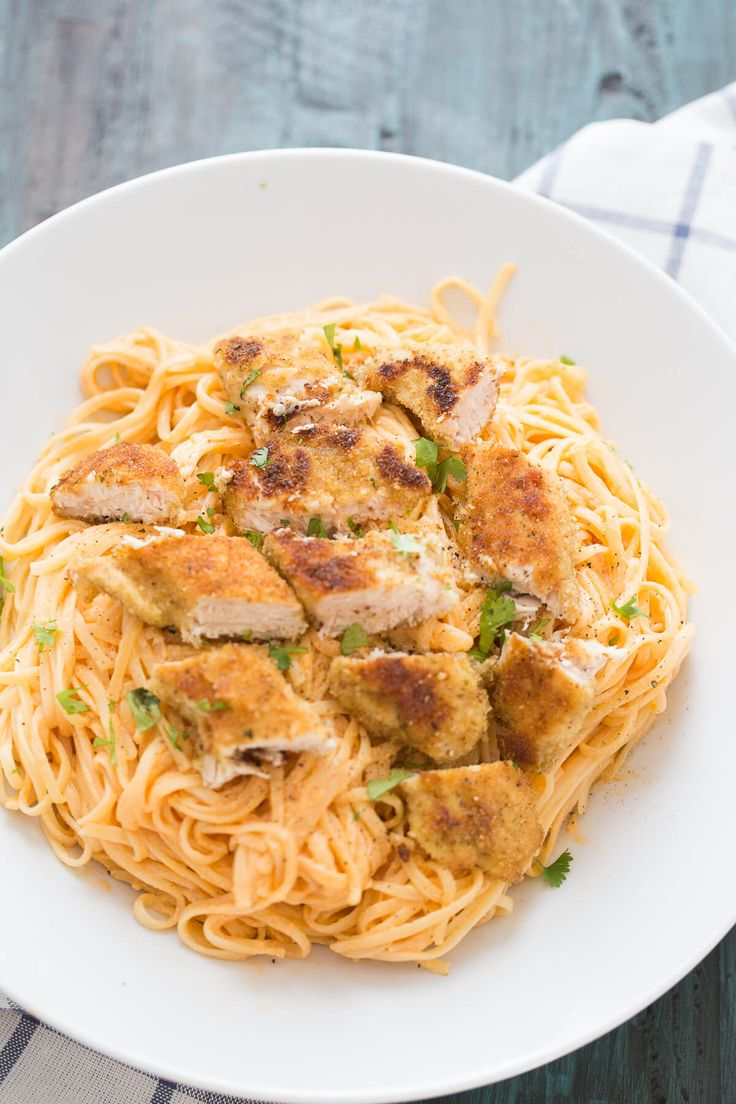 Buffalo Fettuccine Chicken Alfredo is made with pan fried chicken tenders that are served with with pasta in a light and creamy Buffalo alfredo!