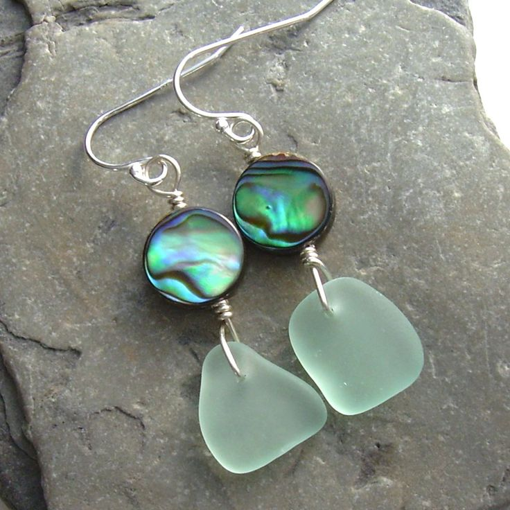 Genuine beach-combed green sea glass from Oahu, Hawaii, combined with abalone sea shell beads, for a pair of ocean earrings. Sterling silver findings.   For those who have asked, the laws on collecting & selling abalone vary by jurisidiction, but there is plenty of legal abalone on the market. Some types are more restricted than others, & some types of collection have more restrictions than others. Shells taken in sport fishing often can't be resold in North America, yet there are many ways…