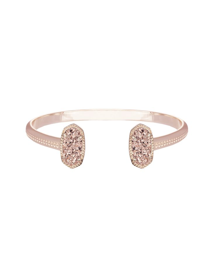 Watch rose gold drusy stones sparkle when set in a matching rose gold metal frame creating a classic look just waiting to be paired with other Kendra Scott favorites. 14k Rose Gold Plated Brass.