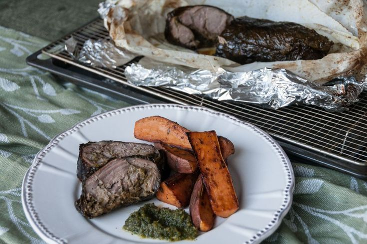 Pesto Stuffed Leg of Lamb Wrapped in Vine Leaves by greek chef Akis. Serve your delicious lamb with sweet potato chips and yogurt.