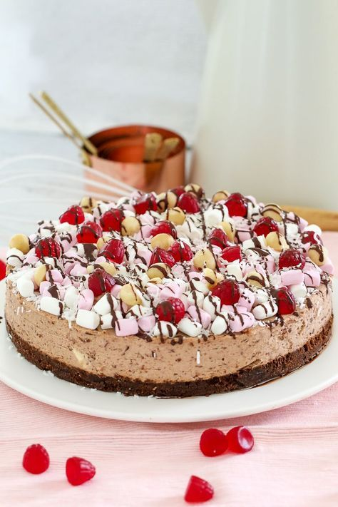 Say hello to the best ever No-Bake Rocky Road Cheesecake! A milk chocolate cheesecake topped with marshmallows, raspberries, nuts and more!