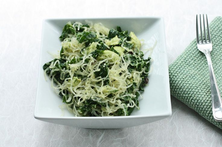 Smashed avocado, kelp noodle, kale, and lemon bowl. Delicious raw food lunch!