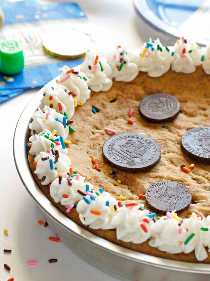 This Hanukkah Gelt Cookie Cake is so fun and celebratory! Pin this recipe today! http://www.joyofkosher.com/recipes/chanukah-gelt-cookie-cake/