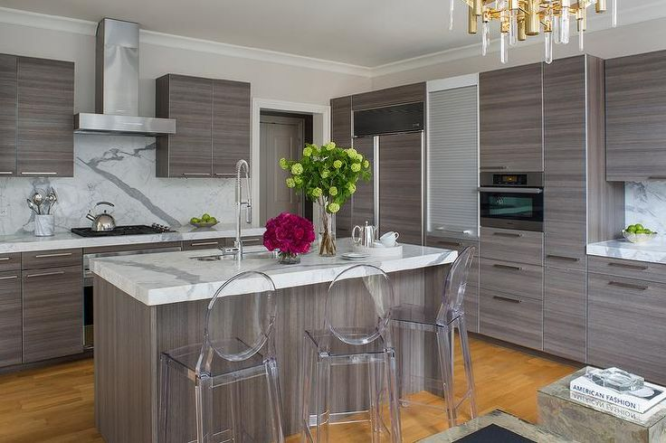 Contemporary kitchen features gray modern cabinets paired with statuary marble countertops and backsplash.