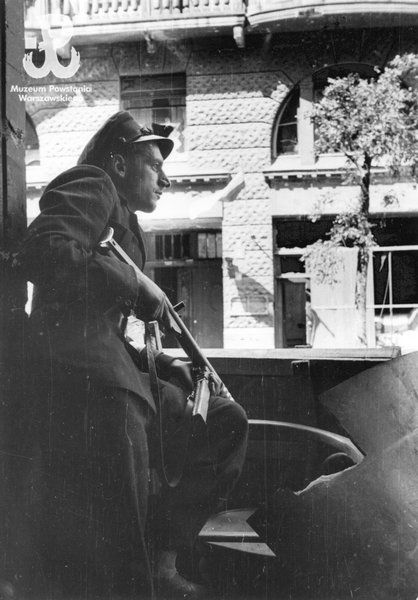 Observation post in the building at ul. Moniuszki near Plac Napeleona. He is armed with a  'Błyskawica' machine pistol.