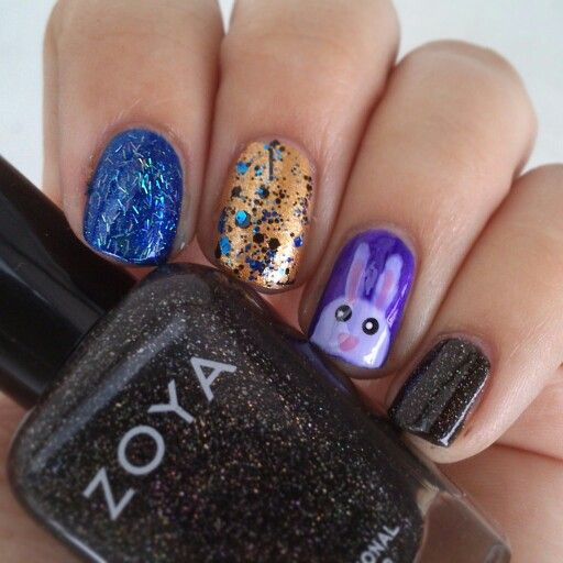 Mixed mani for a circus themed party (I was a magician, hence the rabbit). I used, among others, Zoya Storm, Orly Glitz, Illamasqua Boosh, China Glaze Mosaic Madness, Wet n Wild Buffy the Violet Slayer, Sinful Colors Nail Junkie, OPI Alpine Snow, OPI Pink Friday, and a bunch of glitters..