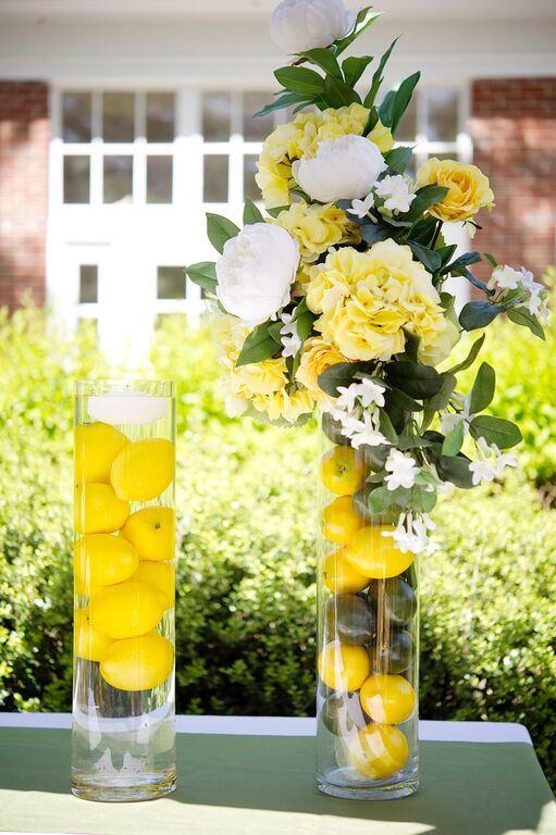 Fun summer floral arrangements. Fill a clear glass cylinder vase with faux lemons and water and add a floating candle, combine lemons and limes together, or fill the vase and add a yellow and white silk flower arrangement to the top. Find great DIY design ideas at Afloral.com.